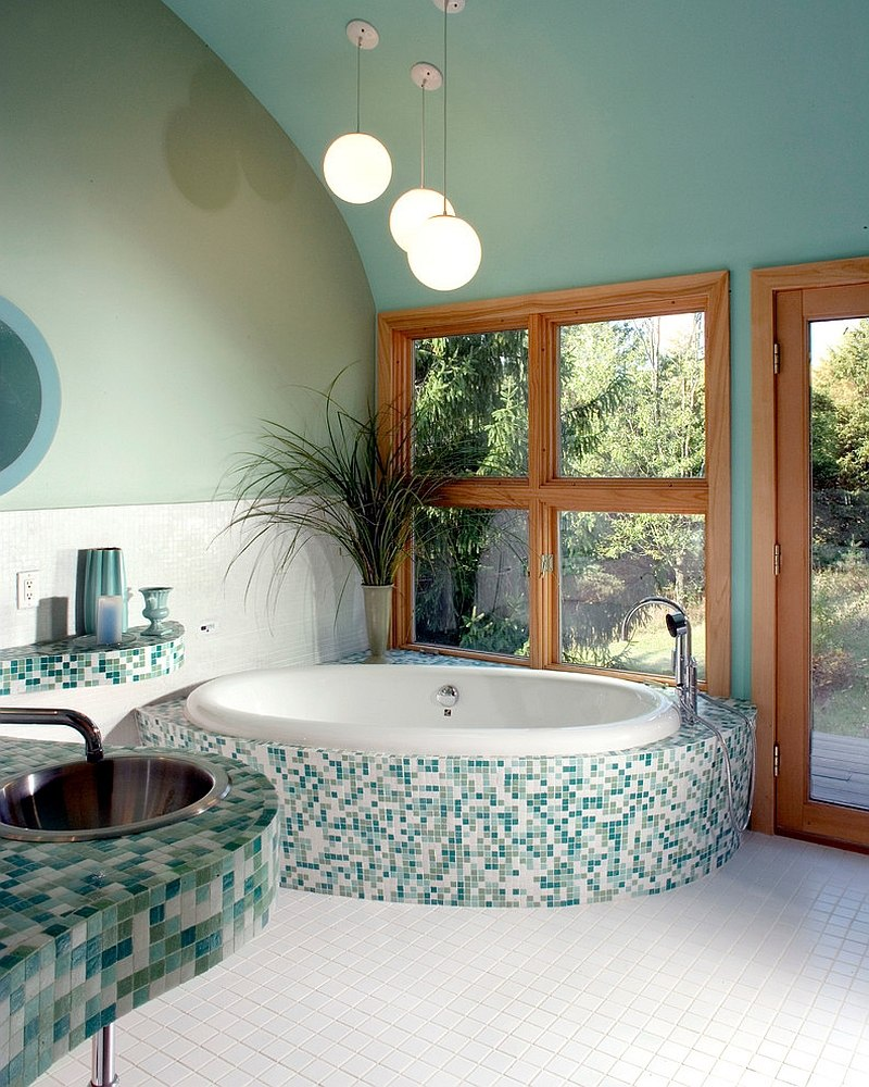 Bluish-green-gives-a-serene-vibe-to-the-spa-styled-master-bath