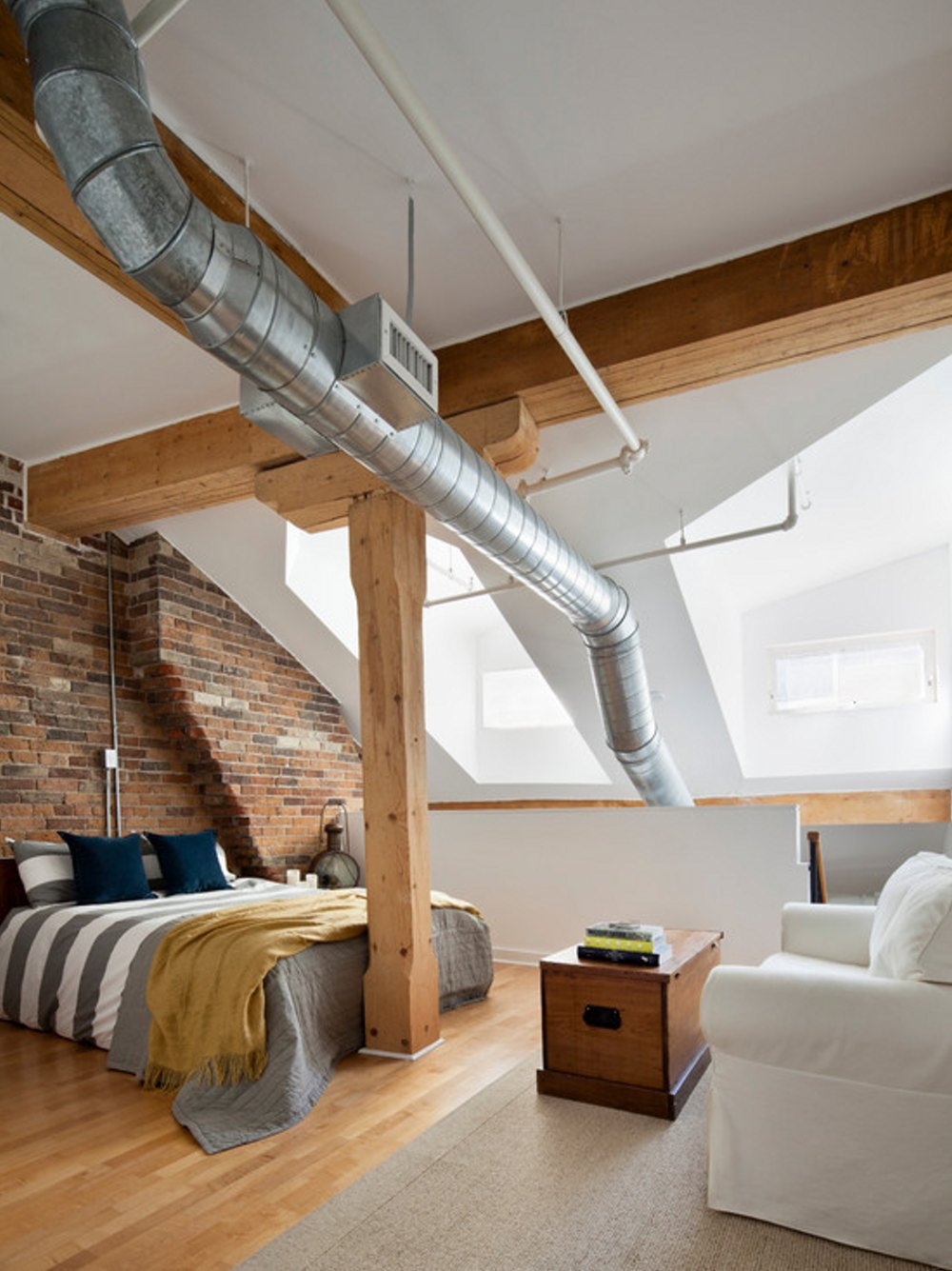 industrial-bedroom-interior-design-ideas-with-wooden-floors-and-white-sofa-chair