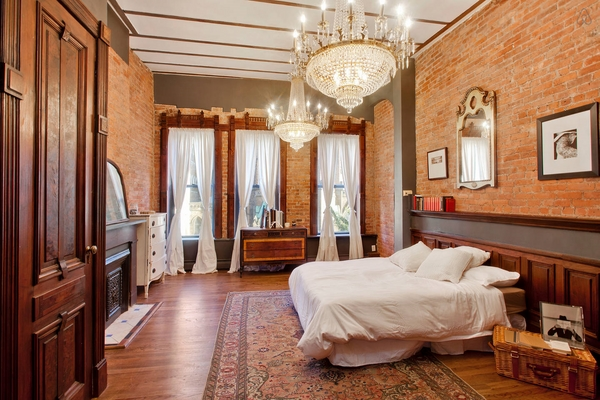 luxury-bedroom-ideas-large-chandeliers-brick-walls