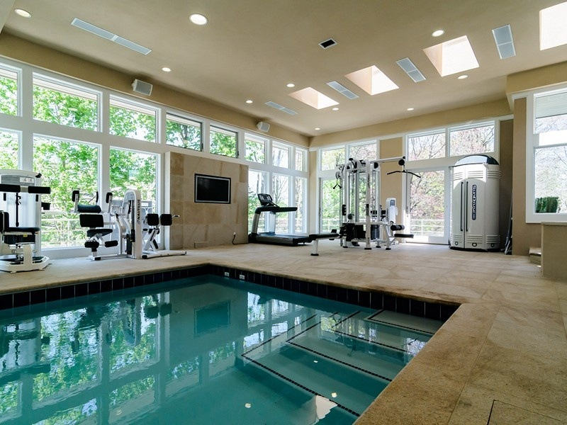 modern-home-gym-with-sunroom-and-entertainment-center