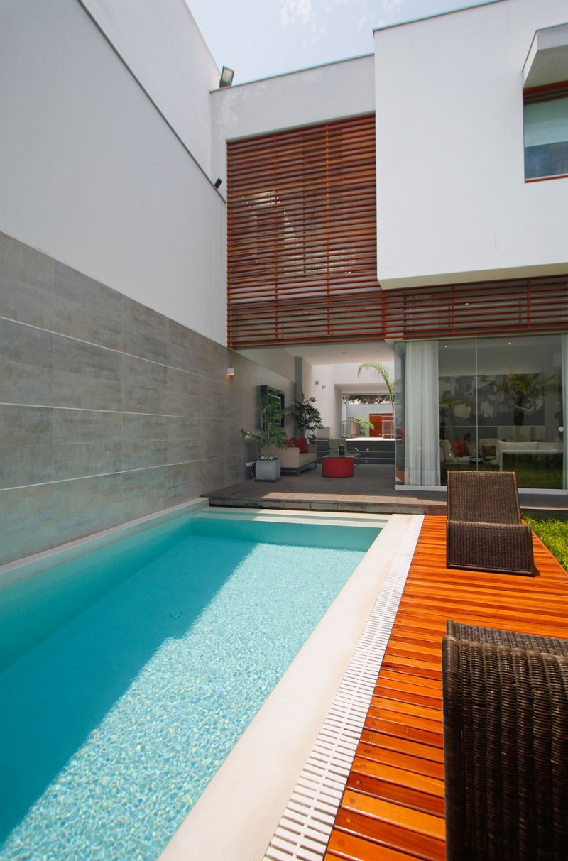 small-pool-along-wiith-white-edge-and-laminate-wooden-parquet-flooring