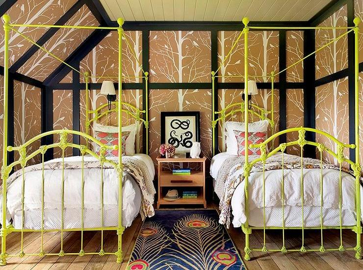 yellow-canopy-bed-shared-kids-bedroom-peacock-feathers-rug
