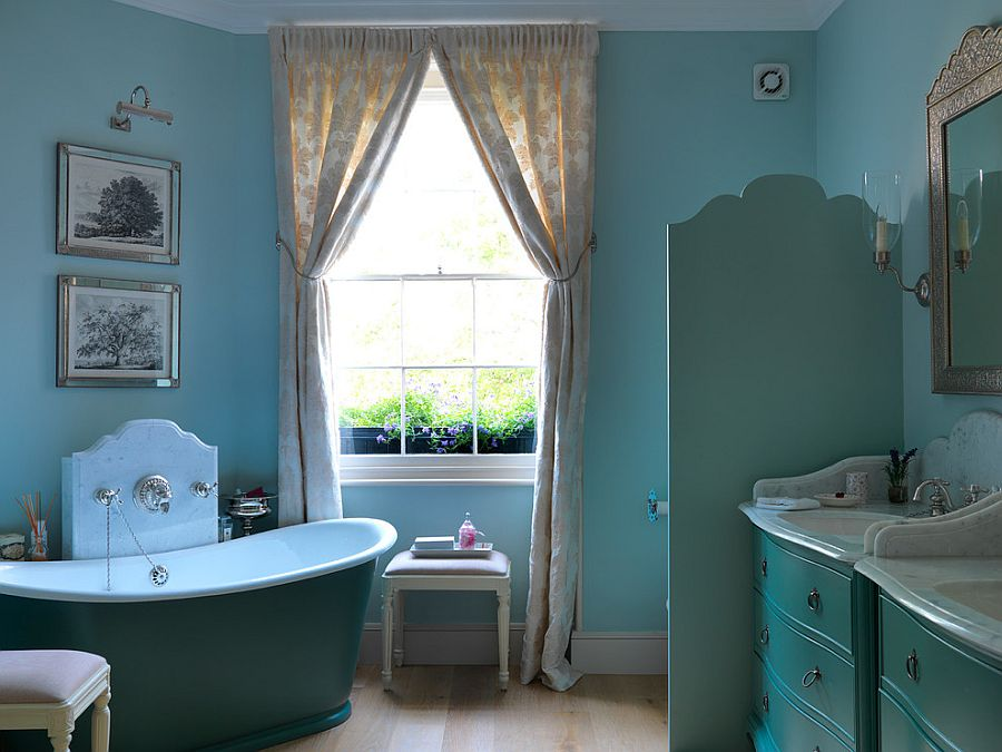 Lovely use of blue in the eclectic bathroom