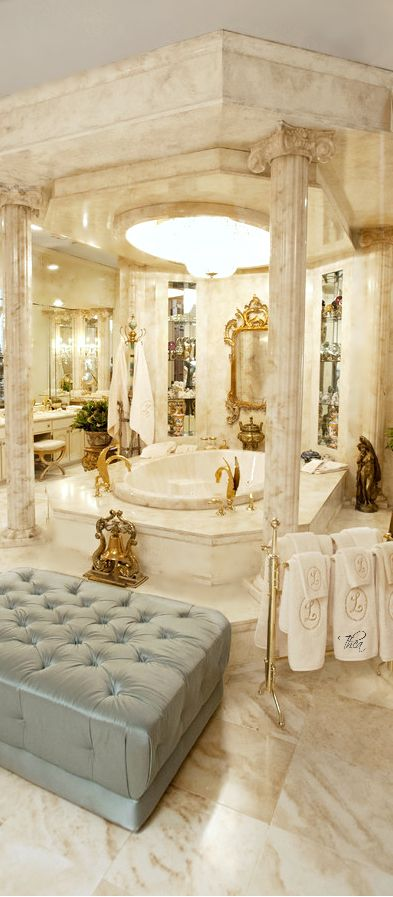 Luxurious arabic style bathroom included golden accessories, leather couch with marble finifshing