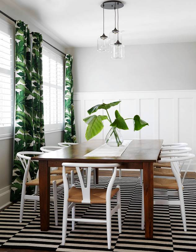 Tropics-inspired drapes warm up the cool geometry of a dining room