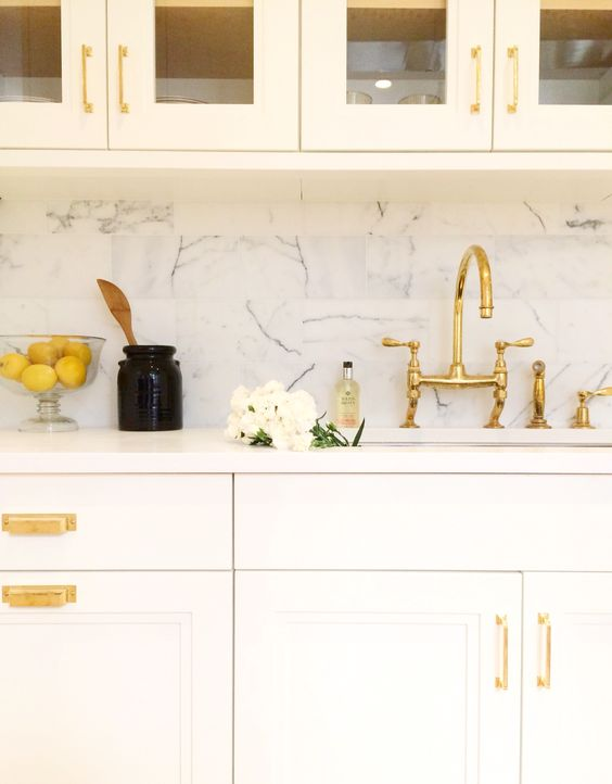 Brass hardware in a white kitchen