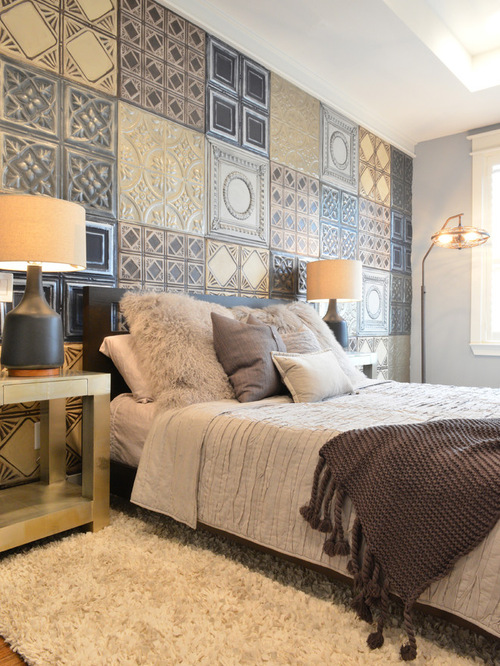 Eclectic Bedroom with wooden flooring and soft rug.