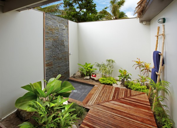 Relaxing outdoor shower area with plants