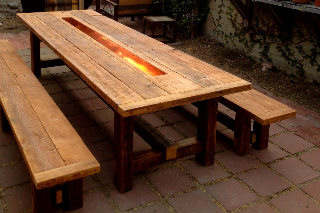 Traditional Farmhouse Style Dining Table with fire option inside center of dining table looks awesome on stone flooring.