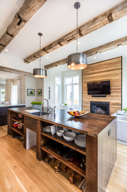 contemporary open kitchen with vintage lights and reclaimed wood ceiling