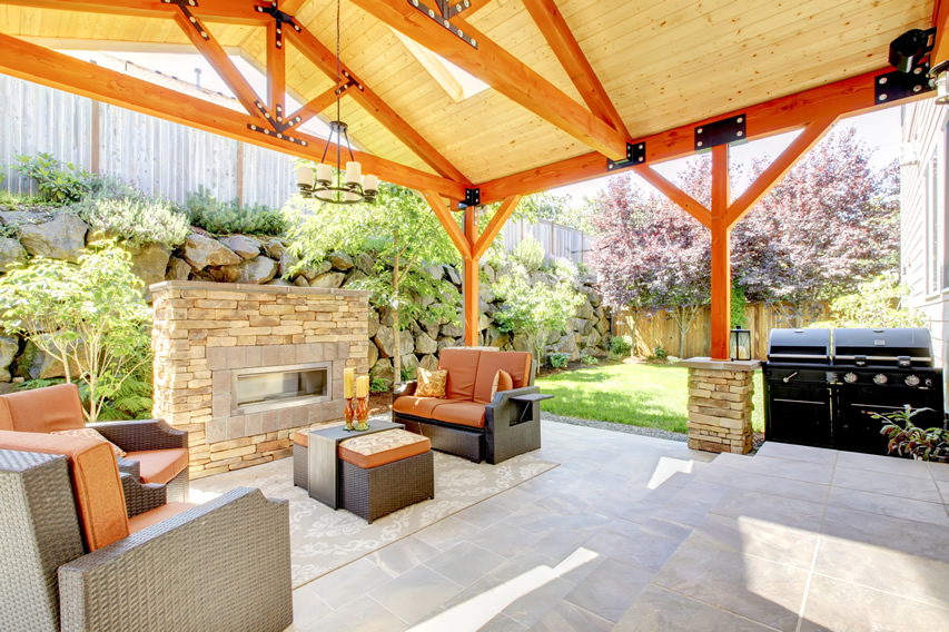covered-patio-orange-outdoor-fireplace-barbeque-area