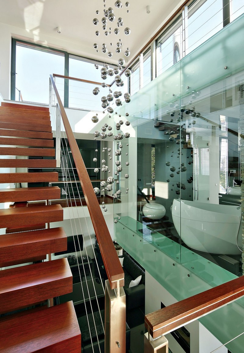 modern wooden staircase with transparent bathroom