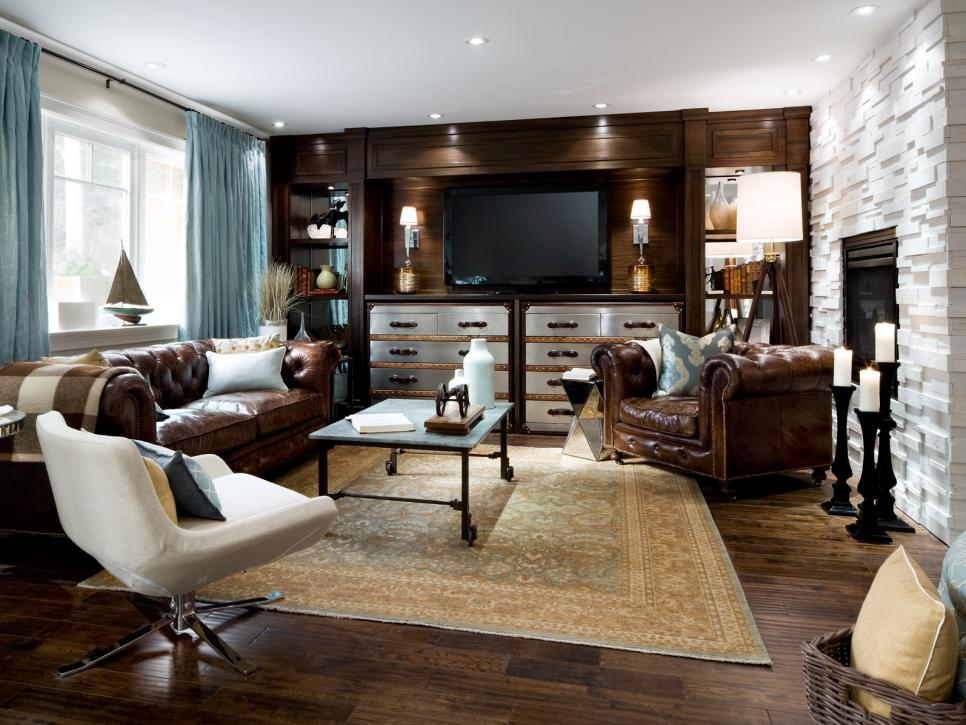 Elegant living room with leather tufted sofa and dark wooden flooring