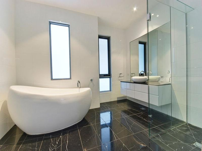 Modern bathroom design with freestanding bath using ceramic