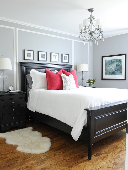 Traditional Bedroom Design Ideas with white rug and wooden flooring