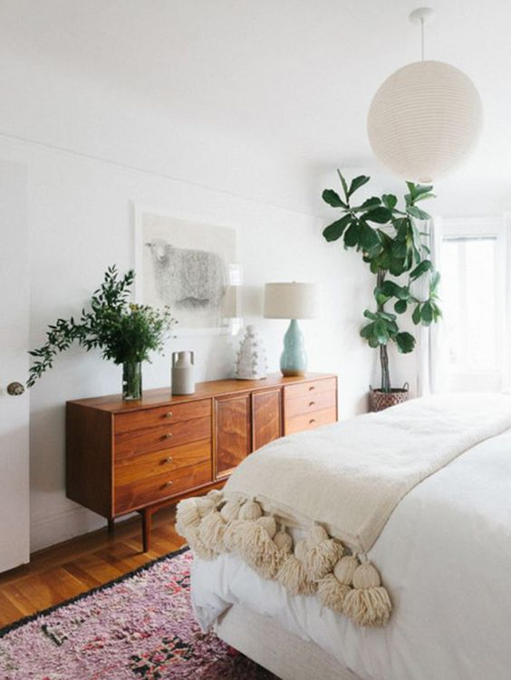 Vintage Mid Century Modern bedroom with wooden dresser
