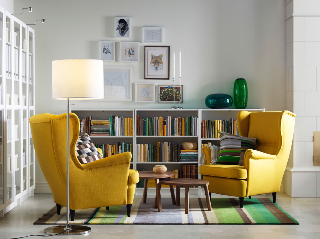 Yellow sofa with library living room