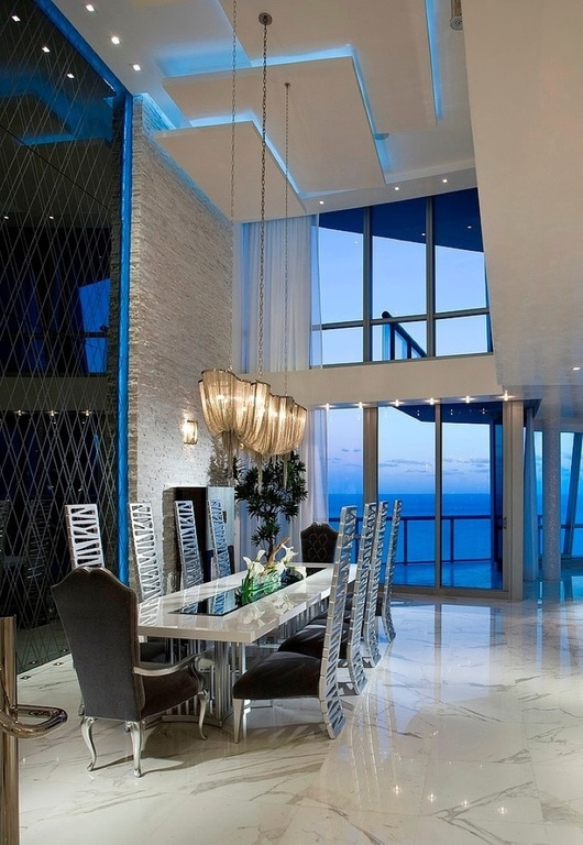 contemporary-dining-room-with-cathedral-ceiling-accent-wall-and-marble-floors