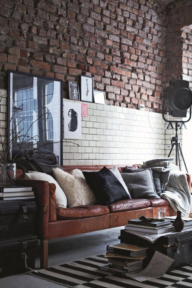 Exposed brick, distressed leather couch, military lockers and flood light