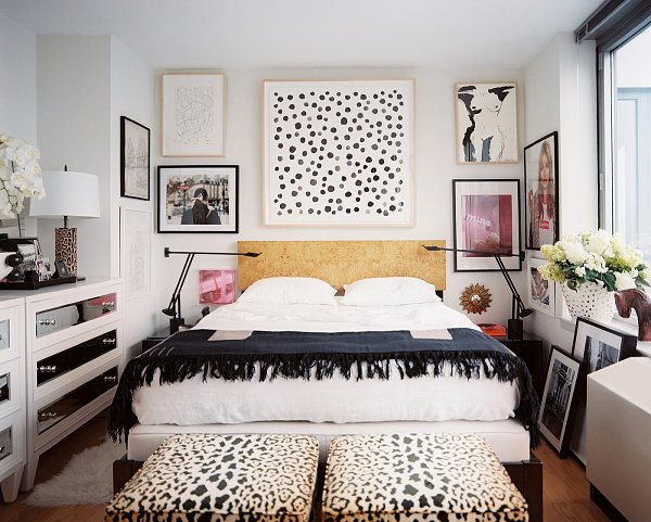 Gallery-style wall art in a modern eclectic bedroom