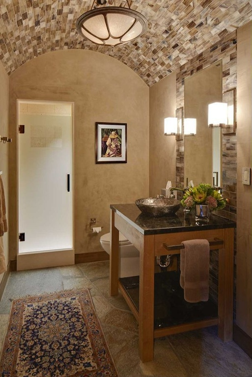 Mediterranean Bathroom with simple granite