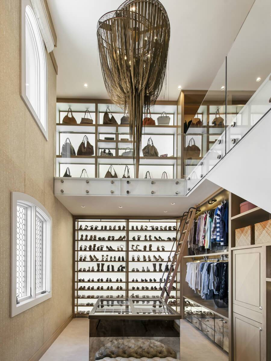 Stunning 2-story walk-in closet with bag and shoe storage
