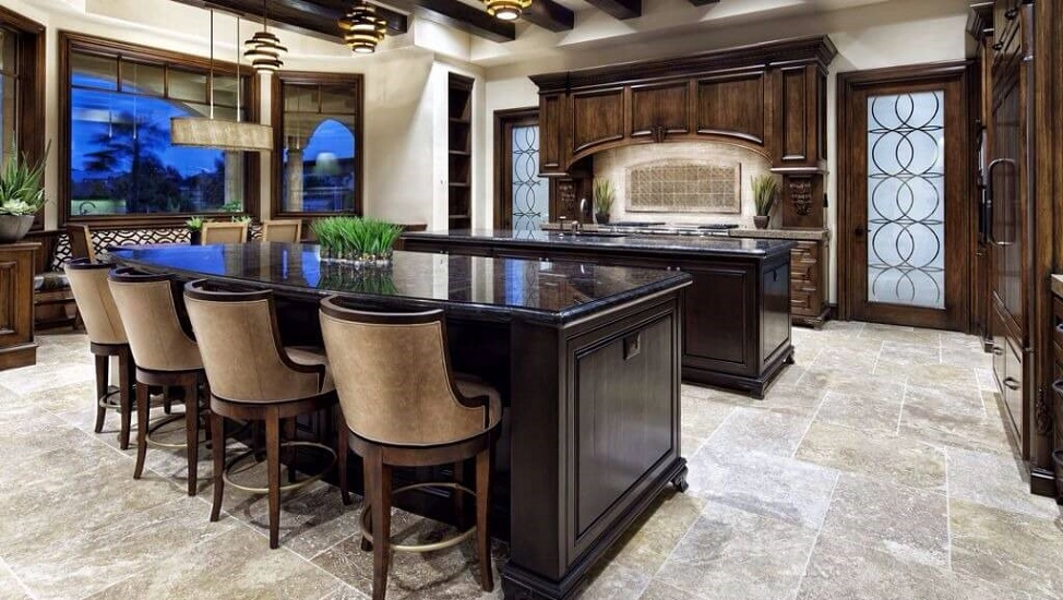 dark wood twin islands with black marble countertops