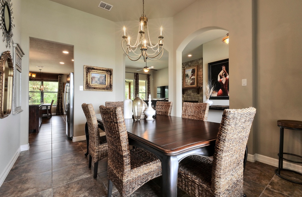 Mediterranean Dining Room with travertine tile floors