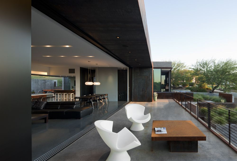 Stylish-White-Chairs-and-Wooden-Coffee-Table-for-Long-Concrete-Balcony