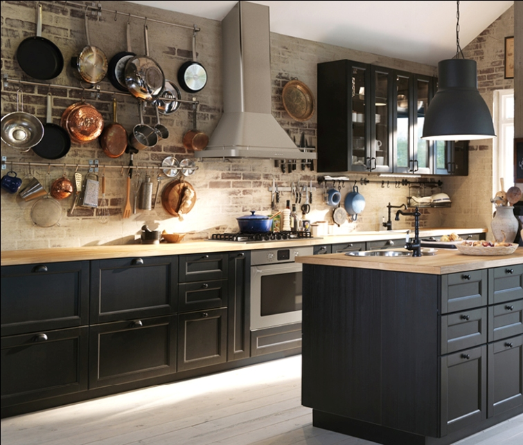 Traditional dark kitchen with solid wood and black worktops