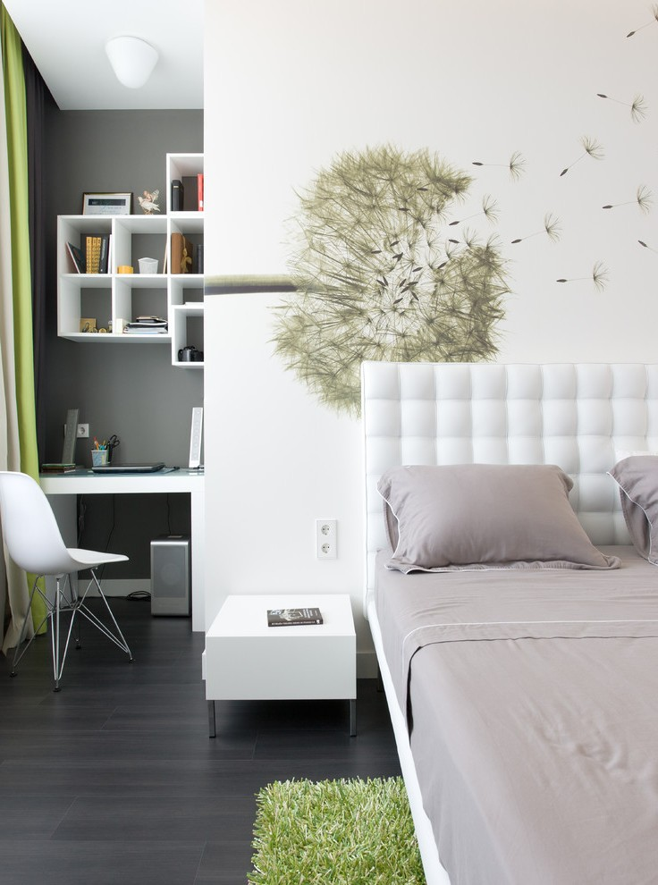 Gorgeous bright bedroom with round black nightstand table and round black leather bed