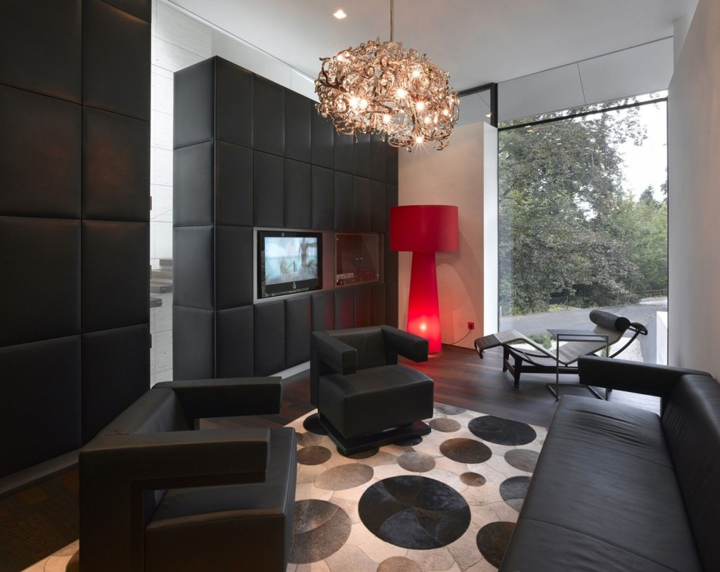 Black Tufted Wall With Dark Semi Glossy Hardwood Floor