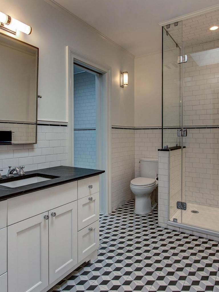 Transitional Bathroom With Geometric Tile Floor