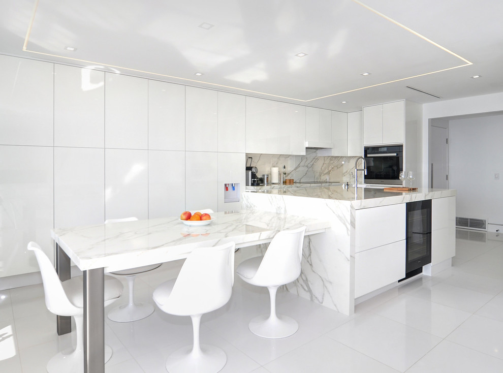 Modern galley kitchen with flat-panel cabinets & white cabinets Dwellingdecor
