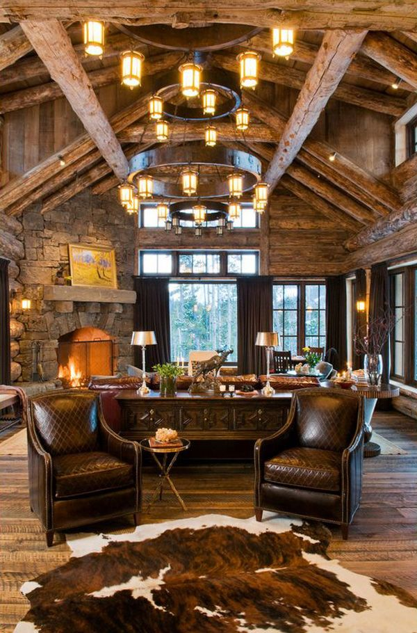 Rustic Living Room WIth Exposed Beam & Cow Hide Rug