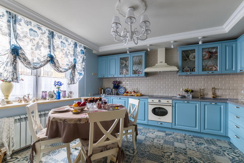 Shabby-chic style l-shaped ceramic floor and blue Cabinets dwellingdecor