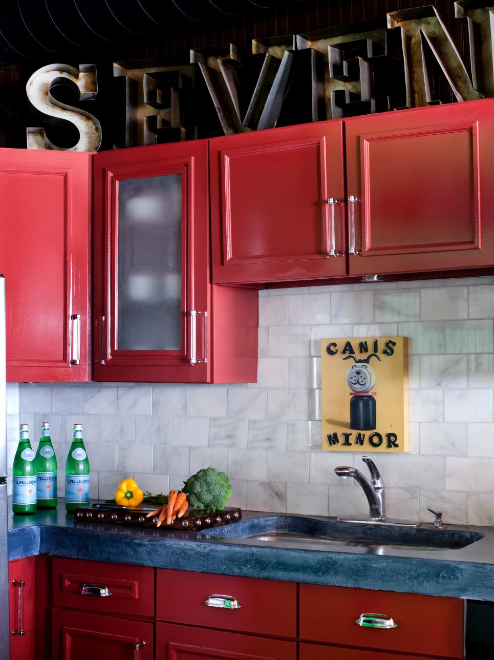 Solid Blue Countertop With Burgundy Cabinets dwellingdecor