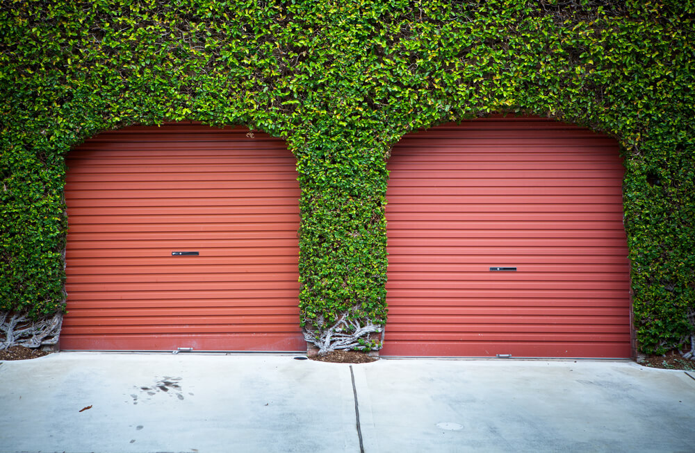 Unique Garage With Two Red Aluminum Doors Dwellingdecor