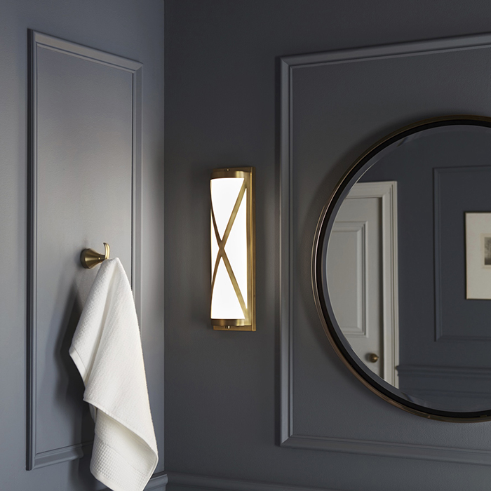 Bathroom With long Brushed Brass Sconce dwellingdecor