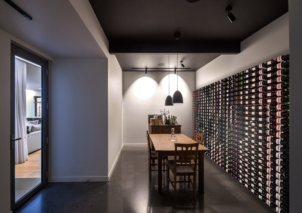 Beautiful Modern Wine Cellar With Black Pendant Lights
